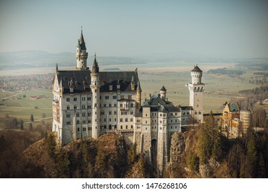 Majestic fairytale Neuschwanstein medieval castle during sunset, beautiful landscape of the famous and popular Bavarian countryside, in Germany (Deutchland), Bavaria. Famous Bavarian destination.
