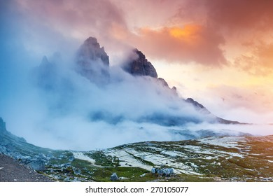 Majestic foggy view of the National Park Tre Cime di Lavaredo with rifugio Locatelli. Dolomites, South Tyrol. Location Auronzo, Italy, Europe. Dramatic scene. Beauty world.