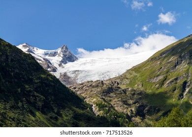 The majestic Grossvenediger massive, Austria's second tallest mountain, with its imposing glaciers and waterfalls as seen from Innergschloess on a sunny summer's day.