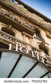 Majestic hotel word with white big letters on luxury awning and luxurious balconies facade