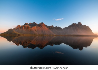 Majestic Icelandic Bat Mountain vestrahorn sunrise water reflection