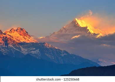The majestic Kanchendzonga range of the himalayas at first light of sunrise