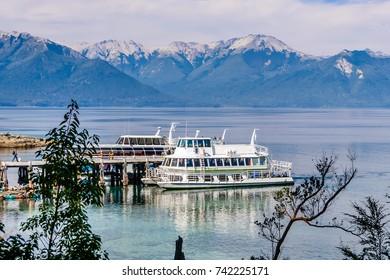 Majestic landscape near San Carlos De Bariloche , Argentina, boats at the pier in Lake Nahuel Huapi
