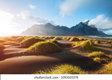 Majestic landscape on sunny day. Location Stokksnes cape, Vestrahorn (Batman Mount), Iceland, Europe. Scenic image of most popular tourist attraction. Travel destination. Discover the beauty of earth.