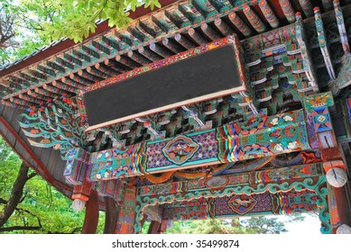 Majestic main entrance of Korean temple with inscription board and intricate ornamental details