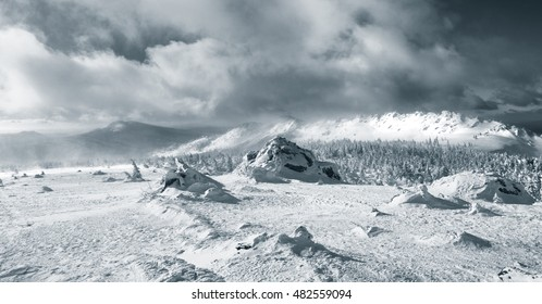 Majestic monochrome mountain landscape with  stormy sky wide panorama.