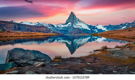 Majestic morning view of Stellisee lake with Matterhorn peak on background. Captivating autumn scene of Swiss Alps, Switzerland, Europe. Beauty of nature concept background.