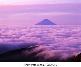 Majestic Mount Fuji rising up through a sea of clouds