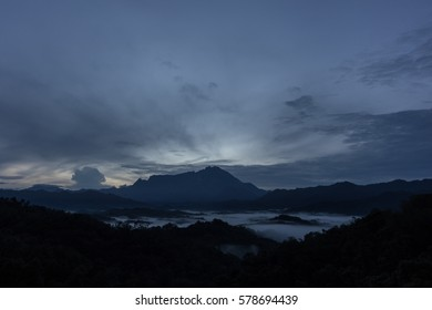 Majestic Mount Kinabalu with cloudy blue hour sunrise and amazing sky clouds ,Sabah,Borneo , Mount Kinabalu view during sunset moment (soft focus)
