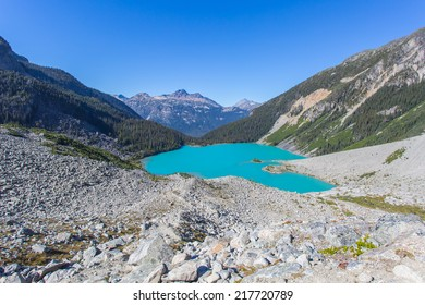 Majestic mountain heart shaped lake with turquoise water in Canada