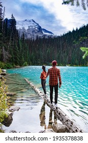 Majestic mountain lake in Canada. Upper Joffre Lake Trail View, couple visit Joffre Lakes Provincial Park - Middle Lake. British Columbia Canada, couple men and woman hiking by the lake