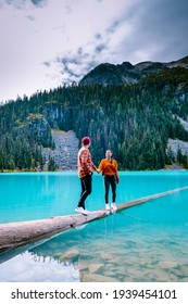 Majestic mountain lake in Canada. Upper Joffre Lake Trail View, couple visit Joffre Lakes Provincial Park - Middle Lake. British Columbia Canada, couple men and woman hiking by the lake - Shutterstock ID 1939454101