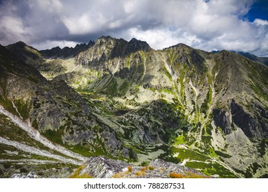 Majestic mountain landscape in the Tatras in Slovakia. Magnificent panoramic view of the mighty mountain crest. Peaceful place for relaxation. Outdoor extreme activity.