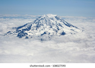 Majestic Mountain Peak towering over the clouds
