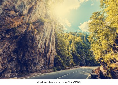 majestic mountain scenery. road in mountains, glowing in sunlight.  Romania- Carpathian Mountains. Bicaz Canyon ( Cheile Bicazului ) . Beauty in the world. retro vintage style. instagram filter