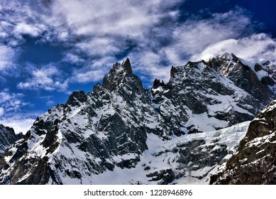 Majestic mountains in winter. A view of some of the peaks in the Mont Blanc massif, the highest mountain in Europe in the Aosta valley region of Italy at the border with France