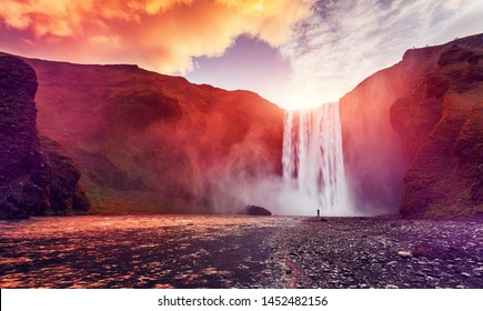 Majestic nature of Iceland. Impressively View on Skogafoss Waterfall with colorful sky glowing sunligh, during sunrise. Skogafoss the most famous place of Iceland. creative artistic image. postcard