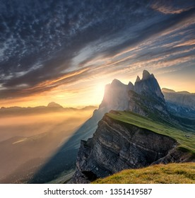 Majestic Odle group peaks on Dolomite Alps During Sunset. Unsurpassed Landscape of Dolomites Mountains with colorful Sky, under Sunlit. popular travel and hiking destination. Colorful summer sunrise