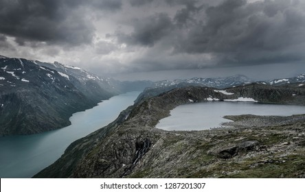 majestic panorama with storm clouds above during the besseggen ridge hike (Jotunheimen National Park, Norway)