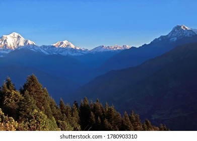 Majestic panorama view of the himalayan mountain range on the sunrise. View from Poon Hill in Nepal