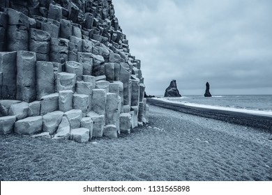 "Majestic place of the stormy Atlantic ocean. Basalt rocks ""Troll toes"". Location Reynisfjara Beach, Iceland (Sudurland), Europe. Scenic image of popular european travel destination. Beauty of earth."