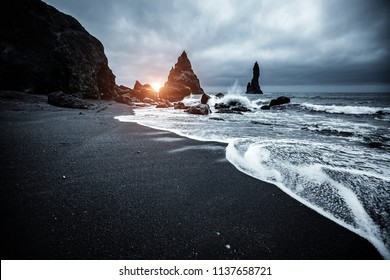 "Majestic place of the stormy Atlantic ocean. Basalt rocks ""Troll toes"". Location Reynisfjara Beach, Iceland (Sudurland), Europe. Scenic image of popular european travel destination. Beauty of earth."