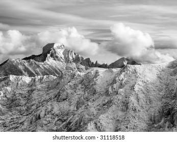Majestic rime encrusted gendarmes tower over a frozen alpine landscape