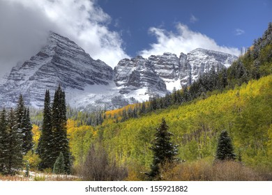 Majestic Snow Covered Mountain with Yellow Aspens and Pine Trees