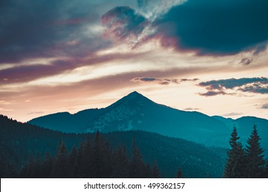 Majestic sunrise in montain landscape. Sunset time. Carpathian, Ukraine, Europe. Beauty world. Vintage filter