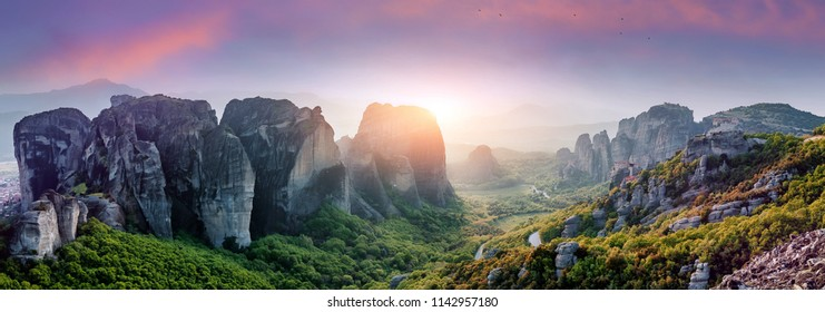 Majestic sunset with colorful sky over the fairytale mountain valley in Greece. Wonderful Picturesque scene. Impressive autumn Landscape. The Meteora monasteries, Greece. Kalambaka. Creative image