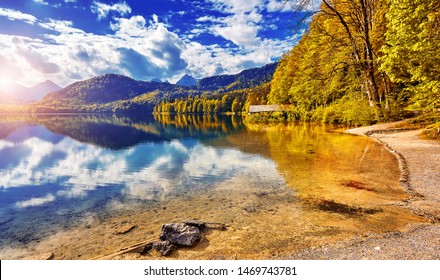 The Majestic sunset at Hohenschwangau lake. Bavarian alps in Germany
