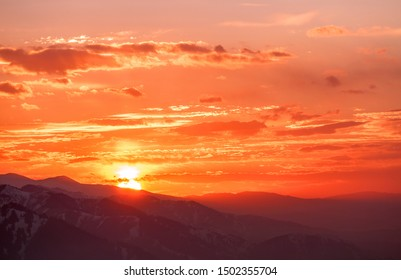 Majestic sunset in the mountains as a background