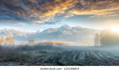 Majestic sunset in the mountains valley with Dramatic sky. Stunning nature landscape. Awesome lpine highlands during sunset. Wonderful Naturai background. Colrful Sky under sunlight