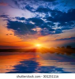 Majestic sunset over lake water