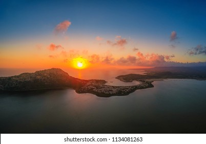 Majestic sunset over Voidokilia beach, one of the best beaches in mediterranean Europe. Aerial panoramic view of beautiful lagoon of Voidokilia from a high point of view, Messina, Greece, Europe
