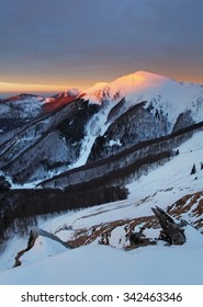 Majestic sunset in the winter mountains landscape. Dramatic sky