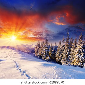 majestic sunset in the winter mountains landscape. HDR image