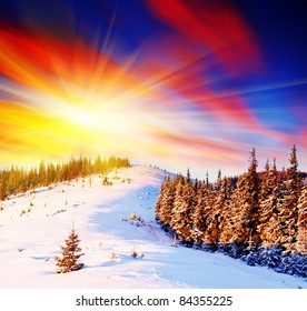 Majestic sunset in the winter mountains landscape. Frosty day
