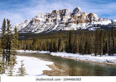 Majestic view of Castle Mountain and Bow River in Winter. Banff National Park, Alberta, Canada.