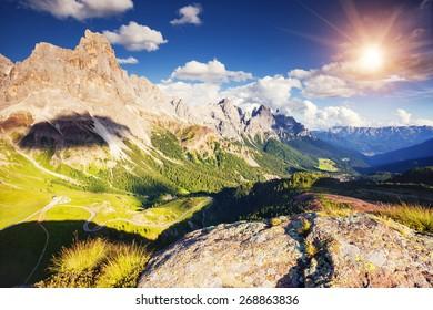 Majestic view of the Cimon della Pala with passo Rolle. National Park Paneveggio. Dolomites, South Tyrol. Location Pale di San Martino. Italy, Europe. Dramatic unusual scene. Beauty world.