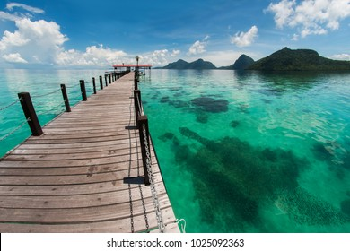 The majestic view of corals reef and islands seen from the jetty of Bohey Dulang Island, Sabah, Malaysia.