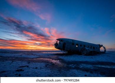 Majestic view during sunrise of Douglas Super DC-3 plane wreck at crash site near to Sólheimasandur beach in southern Iceland.