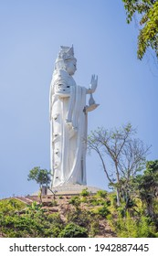 Majestic view of the Lady Buddha statue the Bodhisattva of Mercy, Vietnam. White Ladybuddha statue on blue sky background