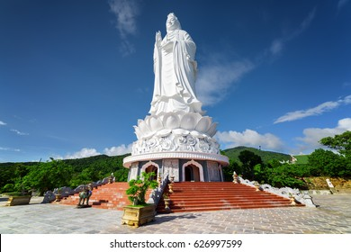 Majestic view of the Lady Buddha (the Bodhisattva of Mercy) at the Linh Ung Pagoda, Danang (Da Nang), Vietnam. White Buddha statue on blue sky background.