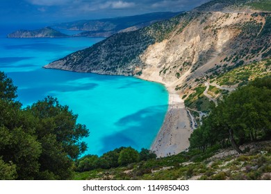 Majestic view of Myrtos beach during summer in high tourist season. Myrtos is one of the best beaches in the world and the Mediterranean sea located in Kefalonia island, Greece, Europe