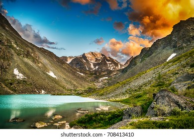 Majestic view on mountain lake surrounded by mountain ridge during sunset, Belukha national park, Altai republic, Siberia, Russia