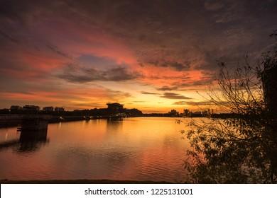 Majestic view of Putrajaya Lake during sunset. Beautiful pink sunset over Putrajaya Dam in Putrajaya, Malaysia.