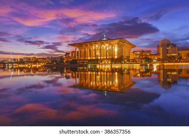 Majestic view of Sultan Mizan Zainal Abidin Mosque (Iron Mosque) Putrajaya during blue hour sunrise with full reflection. Soft focus due to long exposure shot at dawn.