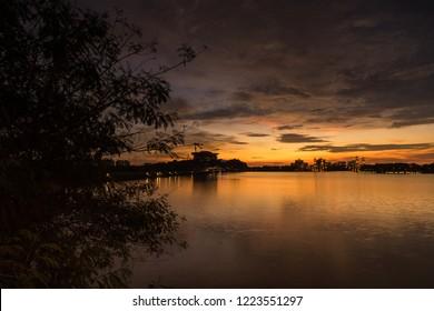Majestic view of Taman Seri Empangan Dam, Putrajaya Lake during sunset. Beautiful pink sunset over Putrajaya Dam in Putrajaya, Malaysia.