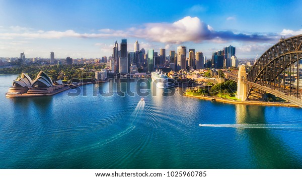 Major architecture landmarks of the city of Sydney and Australia around Sydney harbour in elevated aerial view in warm smooth sunlight at the morning.